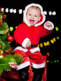 Excited baby sitting on present box Royalty Free Stock Images