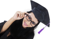 Excited bachelor with graduation gown Stock Photography