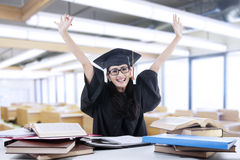 Excited bachelor studying in library 1 Royalty Free Stock Photography