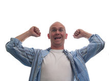 Really Excited Bald Man. Crazy expression of joy with fists raised to show excitement Royalty Free Stock Image