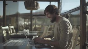 Excited Beard Man Celebrating Success while Working on Laptop. RAW Ungraded stock video