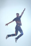 Excited bearded guy feeling freedom during flight Royalty Free Stock Photo