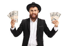 Excited bearded man with bundles of money Stock Image