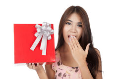 Excited  beautiful Asian woman open a  red gift box Stock Photos