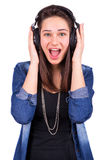 Excited beautiful girl in headphones Royalty Free Stock Photos