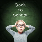 Excited beautiful little girl on the chalkboard background Royalty Free Stock Images