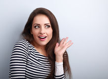 Excited beautiful woman surprising and looking. Woman with open. Mouth and gesturing hand. Closeup portrait Royalty Free Stock Photo
