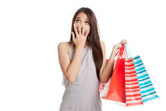 Excited beautiful young Asian woman with shopping bags Royalty Free Stock Photography