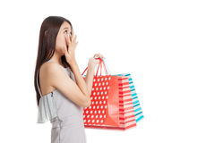 Excited beautiful young Asian woman with shopping bags Royalty Free Stock Images