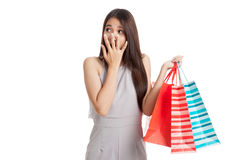 Excited beautiful young Asian woman with shopping bags Stock Photo