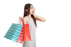 Excited beautiful young Asian woman with shopping bags Royalty Free Stock Photos