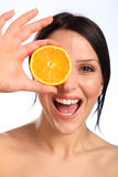 Excited beautiful young woman with orange fruit Royalty Free Stock Photos