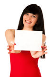 Excited beautiful young woman showing a blank paper isolated. Over white Royalty Free Stock Photo