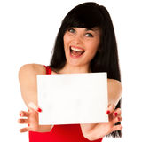 Excited beautiful young woman showing a blank paper isolated. Over white Stock Photo
