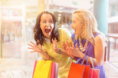 Excited best friends shopping together Stock Photo