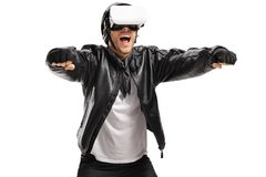 Excited biker with a VR headset pretending to drive a motorcycle Royalty Free Stock Images