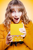 Excited birthday girl opening surprise gift. Excited bithday girl opening surprise gift with a look of amazement and shock in a Surprise Birthday concept on Stock Images