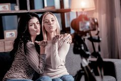 Excited bloggers sending kisses to their followers stock images