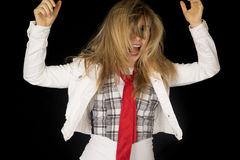 Excited blond female model with messy hair and hands up Stock Photos