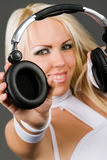 Excited blond model with headphones Royalty Free Stock Photo