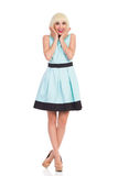 Excited blonde girl in pastel blue dress Royalty Free Stock Images