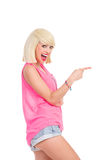 Excited blonde girl pointing Royalty Free Stock Photography
