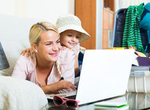 Excited blonde mother and little girl royalty free stock images