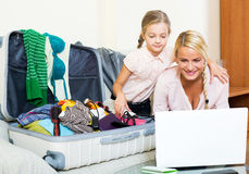 Excited blonde mother and little girl stock image