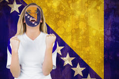 Excited bosnia fan in face paint cheering Royalty Free Stock Images