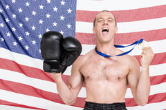 Excited boxer showing his gold medal Royalty Free Stock Images