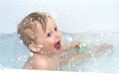 Excited boy in bathing waters. In sparks Stock Photo