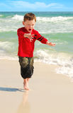 Excited Boy on Beach Stock Photography