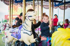 Excited Boy on a Carousel Horse Stock Images