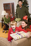 Excited boy with family and presents at Christmas Stock Photos