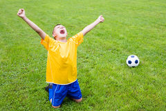 Excited boy football player. After goal scored Stock Photos