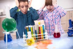 Excited boy and a girl in a laboratory Stock Photo