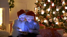 Excited children near Christmas tree stock footage