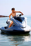 Excited boy on jet ski Royalty Free Stock Photography
