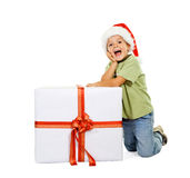 Excited boy with large present Stock Photos