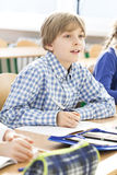 Excited boy during lesson Stock Images