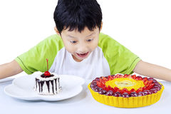 Excited boy looking at colorful desserts Royalty Free Stock Photography