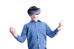 Excited boy looking with virtual reality headset Stock Photo