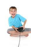 Excited boy playing a computer game royalty free stock photo