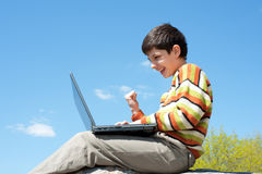 Excited boy playing with wireless laptop Stock Images