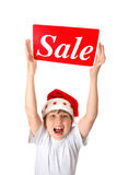 Excited boy with Sale Sign Royalty Free Stock Photos