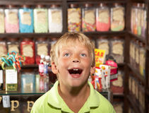 Excited Boy Standing In Sweet Shop Royalty Free Stock Photos