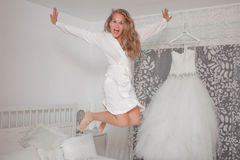 Excited bride in dressing room. At home stock photography