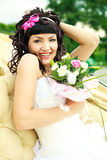 Excited bride with flowers Stock Images