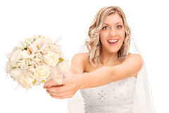 Excited bride preparing to toss the flower Stock Photography
