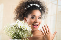 Excited bride showing her wedding ring Stock Images